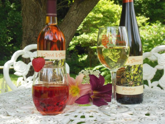 vineyards 2 bottles of wine with 2 glasses on a table outside wood winery madison township pennsylvania united states ulocal local products local purchase local produce locavore tourist