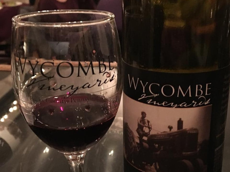 vineyards bottle and glass of red wine from the vineyard wycombe vineyards and winery furlong pennsylvania united states ulocal local products local purchase local produce locavore tourist