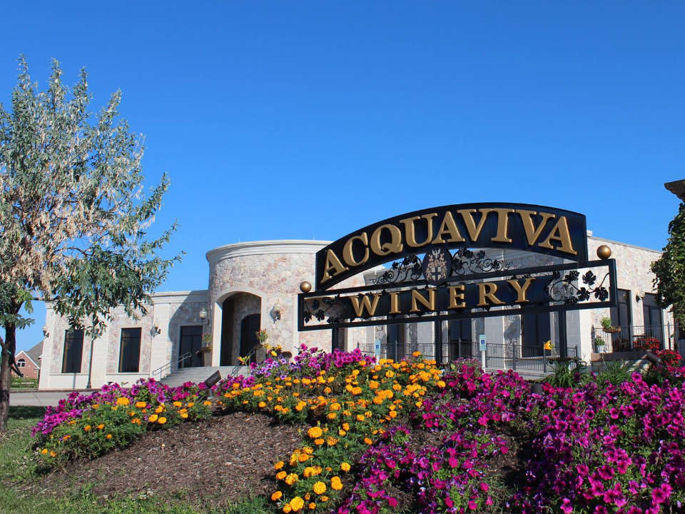 vineyards outdoor vineyard sign with magnificent white house inspired by italy and floral arrangement with blue sky acquaiva winery and vineyard maple park illinois united states ulocal local products local purchase local produce locavore tourist
