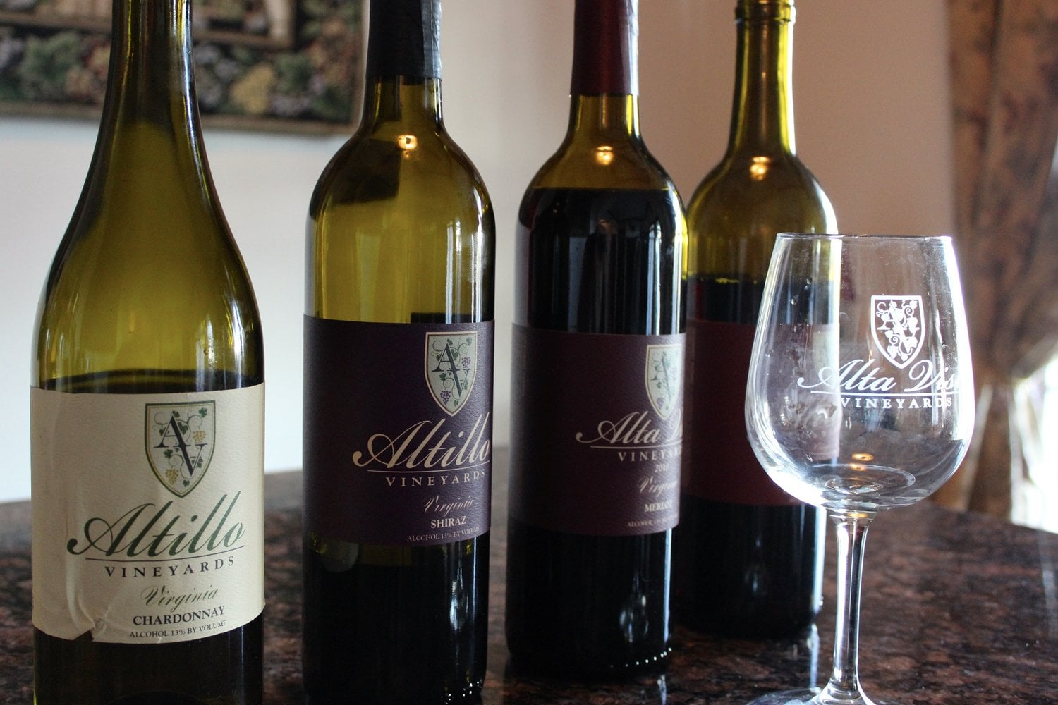 vineyards 4 bottles and a glass of wine from the vineyard for tastings altillo vineyards hurt virginia united states ulocal local products local purchase local produce locavore tourist
