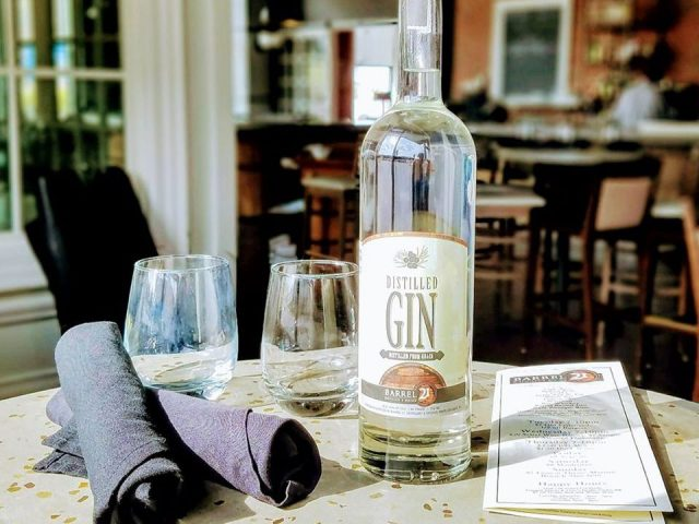 liquor bottle of gin with 2 glass and napkins on a table in the tasting room barrel 21 distillery and dining state college pennsylvania united states ulocal local products local purchase local produce locavore tourist