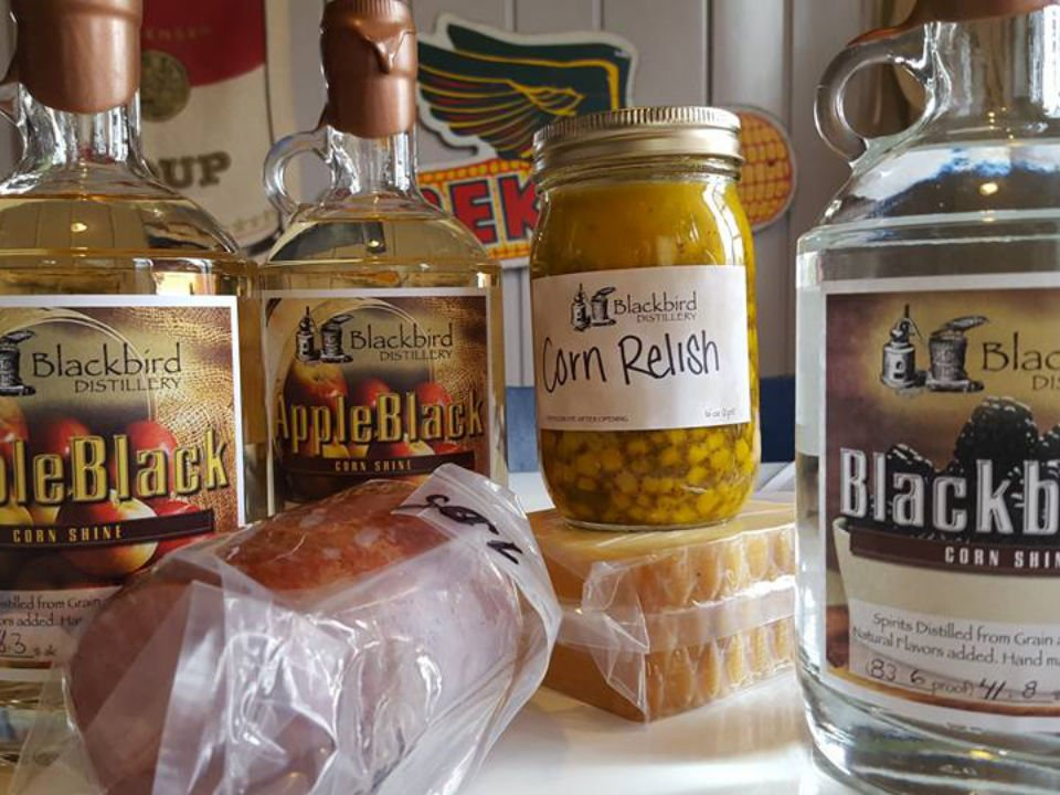 liquor 3 bottles of spirits cheese roll of meat deli and corn relish canned blackbird distillery brookville pennsylvania united states ulocal local products local purchase local produce locavore tourist