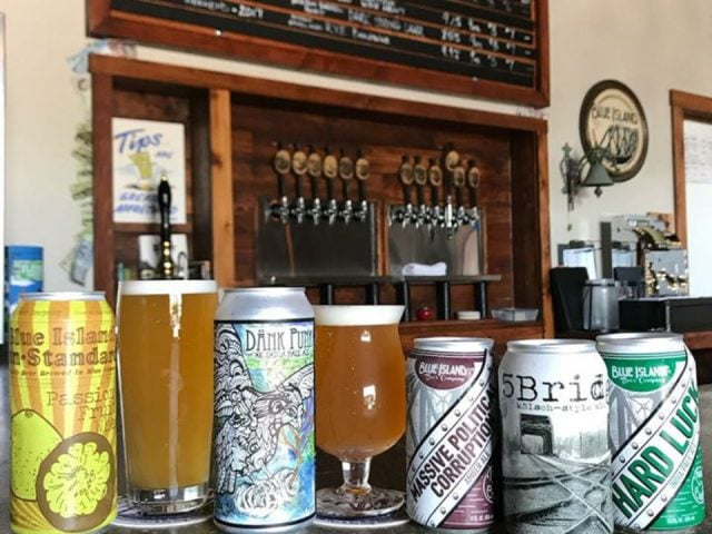 microbreweries 5 cans and 2 glasses of craft beer on the bar with the draft beer dispenser blue island beer company blue island illinois united states ulocal local products local purchase local produce locavore tourist