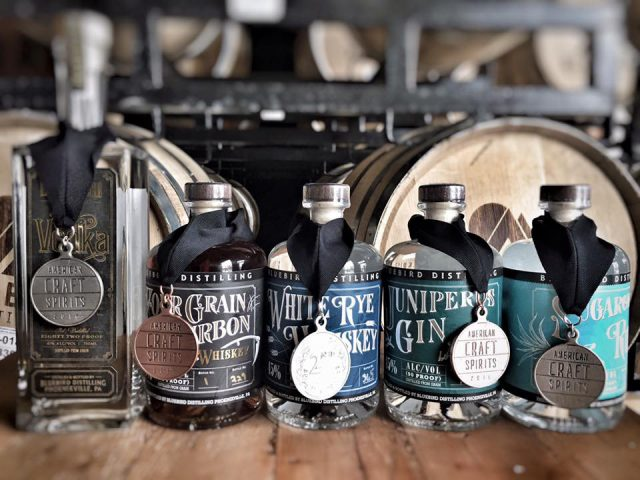 liquor 5 bottles of different flavors of distilled spirits from the distillery with wooden barrels bluebird distilling phoenixville pennsylvania united states ulocal local products local purchase local produce locavore tourist