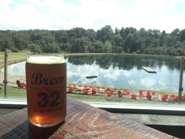 microbreweries glass of craft beer on a table with lake in the background brew 32 craft brewery pulaski pennsylvania united states ulocal local products local purchase local produce locavore tourist