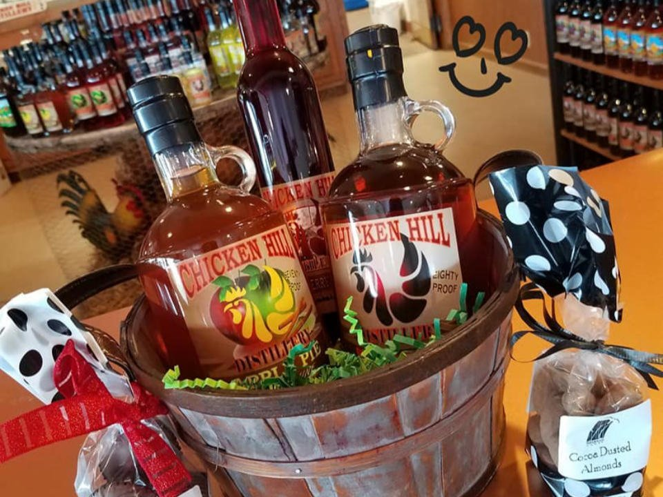 liquor basket with 3 bottles of whiskey of different flavor and 2 gift bags in the shop chicken hill distillery kersey pennsylvania united states ulocal local products local purchase local produce locavore tourist