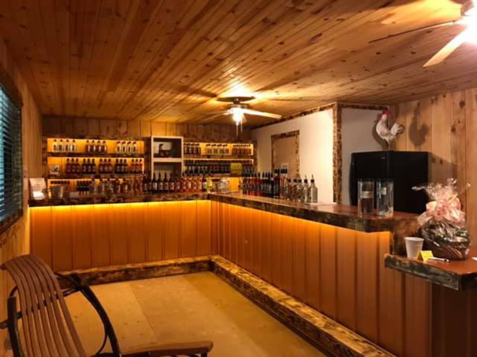liquor inside the tasting room with a large bar and lots of woodwork chicken hill distillery kersey pennsylvania united states ulocal local products local purchase local produce locavore tourist