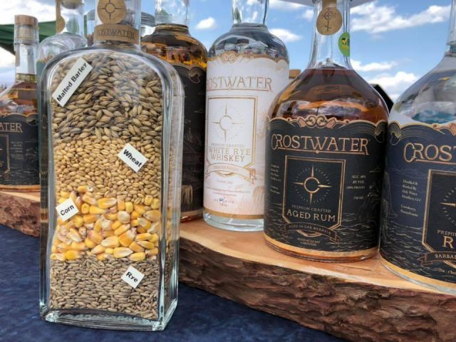 liquor barley grain corn rye wheat bottle in front of spirit bottles aged rum white rye whiskey crostwater distilled spirits lewisberry pennsylvania united states ulocal local products local purchase local produce locavore tourist