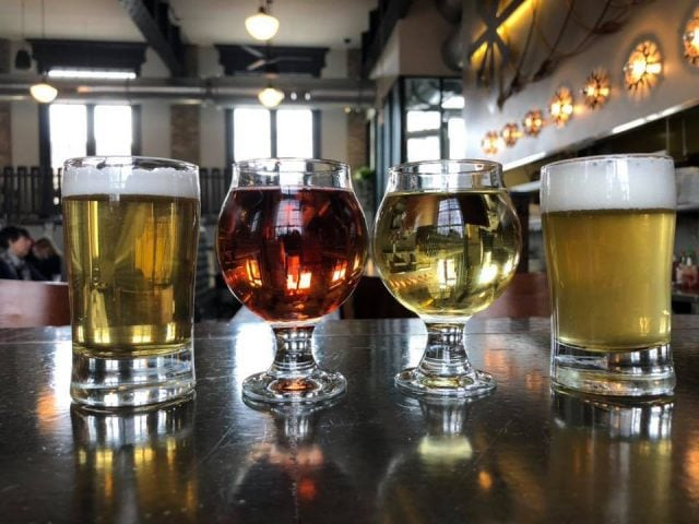 microbreweries 4 glasses of craft blonde and red beer on the bar eris brewery and cider house chicago illinois united states ulocal local products local purchase local produce locavore tourist