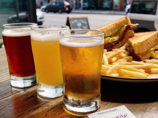 microbreweries 3 glasses of blonde dark and red craft beer with sandwich on a table of the terrace forbidden root chicago illinois united states ulocal local products local purchase local produce locavore tourist