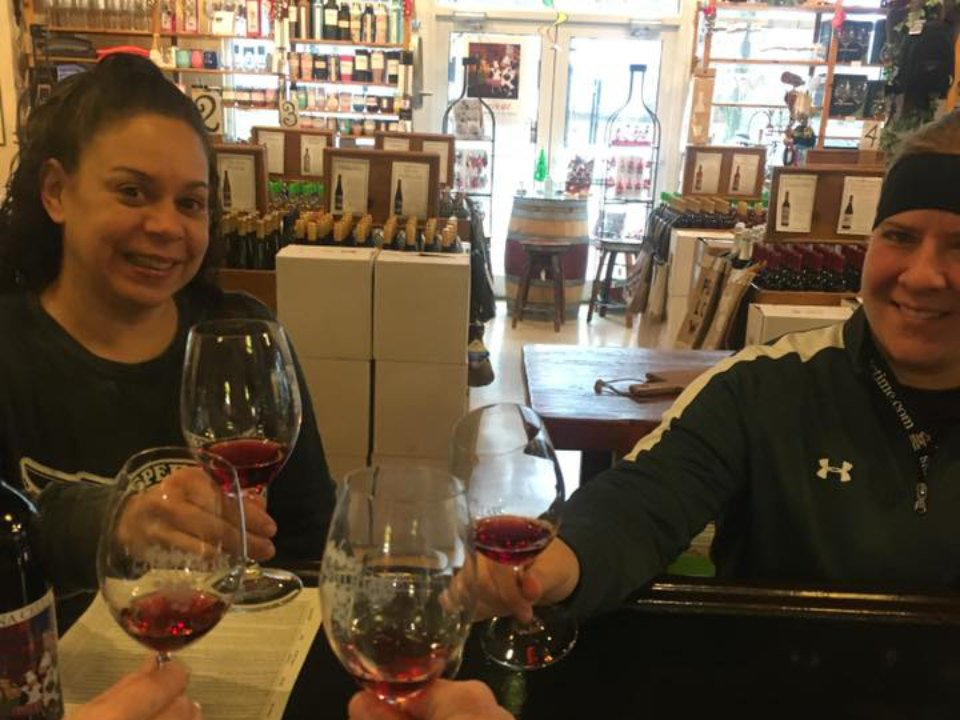 vineyards customers enjoying a glass of wine at the tasting bar in the shop galena cellars geneva illinois united states ulocal local products local purchase local produce locavore tourist