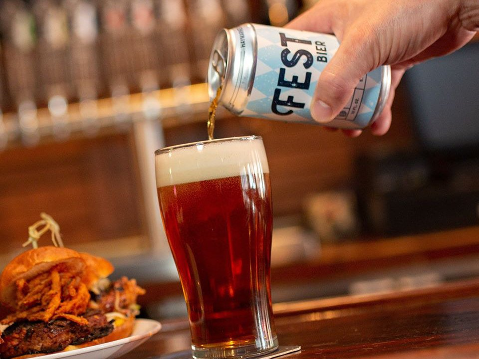 microbreweries hand holding a can of beer and pouring it into a glass with a burger plate haymarket pub and brewery chicago illinois united states ulocal local products local purchase local produce locavore tourist