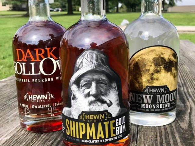 liquor dark hollow bourbon bottle of moonshine new moon and gold rum shipmate on a wooden picnic table hewn spirits distillery new hope pennsylvania united states ulocal local products local purchase local produce locavore tourist