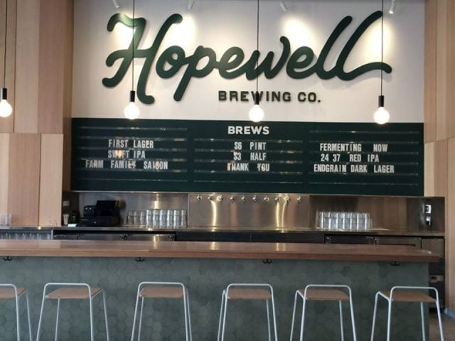 microbreweries bar with benches and beer dispenser with menu board and logo above the bar on the wall hopewell brewing company chicago illinois united states ulocal local products local purchase local produce locavore tourist