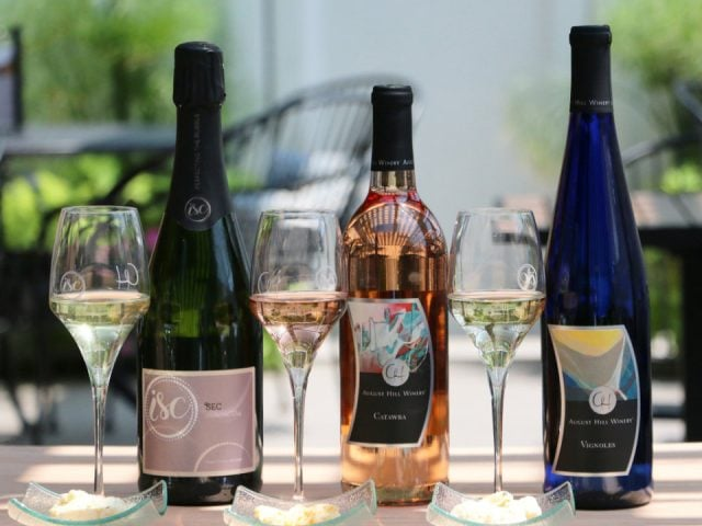 vineyards 3 bottles and glasses of wine on a terrace table illinois sparkling co north utica illinois united states ulocal local products local purchase local produce locavore tourist