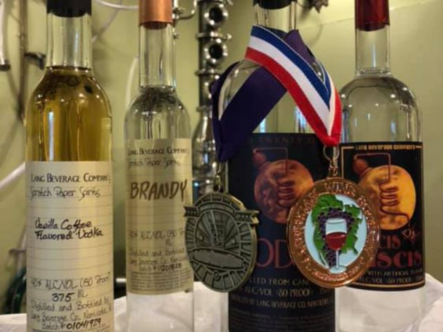 liquor various bottles of award-winning vodka and brandy in distillery with still lang beverage company nanticoke pennsylvania united states ulocal local products local purchase local produce locavore tourist