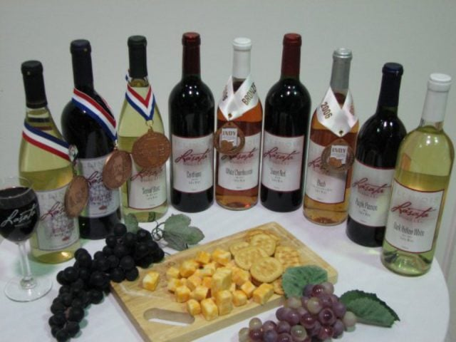 vineyards assortment of award-winning wine bottles on a table with cracker cheese and grape platter lasata winery lawrenceville illinois united states ulocal local products local purchase local produce locavore tourist