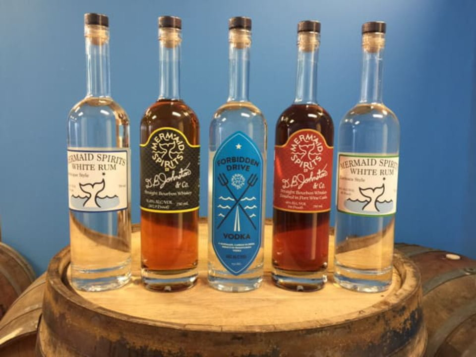 liquor bottles of rum and vodka on a wooden barrel mermaid spirits distillery huntingdon valley pennsylvania united states ulocal local products local purchase local produce locavore tourist