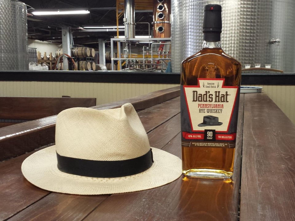 liquor rye bottle with hat on the bar and distillery room with still mountain laurel spirits dads hat rye bristol pennsylvania united states ulocal local products local purchase local produce locavore tourist