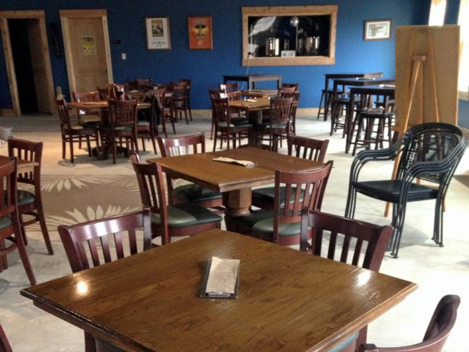 vineyards interior of the tasting room with square tables and wooden chairs and blue wall owl creek vineyard cobden illinois united states ulocal local products local purchase local produce locavore tourist