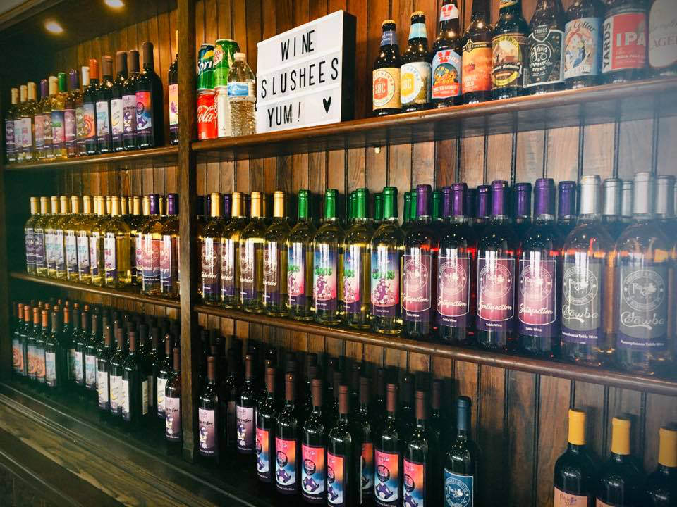 vineyards assortment of vineyard wine on wooden shelves purple cow winery bloomsburg pennsylvania united states ulocal local products local purchase local produce locavore tourist