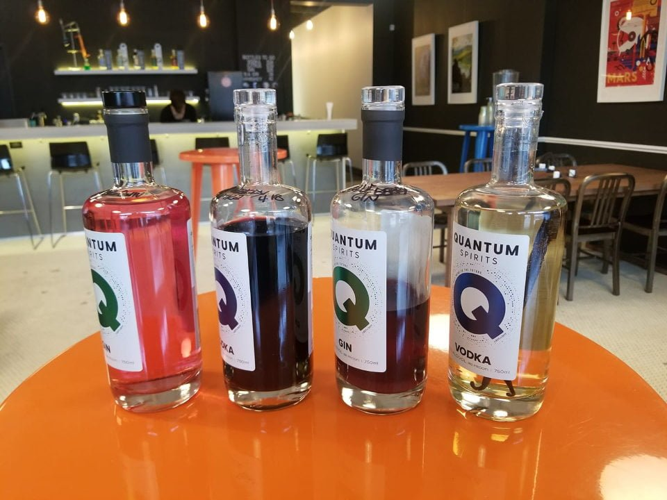 liquor assortment of 4 bottles of vodka gin on a table in the tasting room with bar quantum spirits carnegie pennsylvania united states ulocal local products local purchase local produce locavore tourist