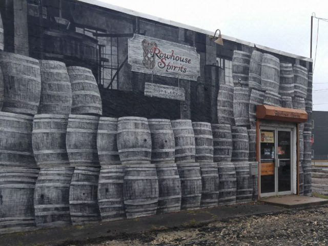 liquor outdoor building with image of wooden barrels printed and logo rowhouse spirits distillery philadelphia pennsylvania united states ulocal local products local purchase local produce locavore tourist
