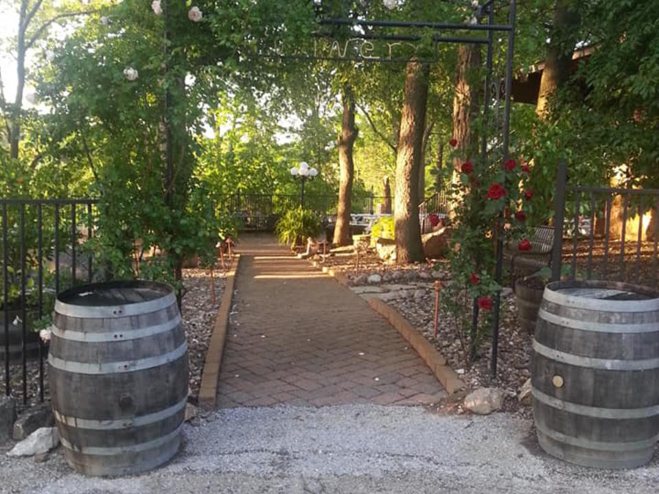 vineyards 2 barrels on each side of the vineyard entrance in paving stones with arched trees surrounded by nature schorr lake vineyard and winery waterloo illinois united states ulocal local products local purchase local produce locavore tourist