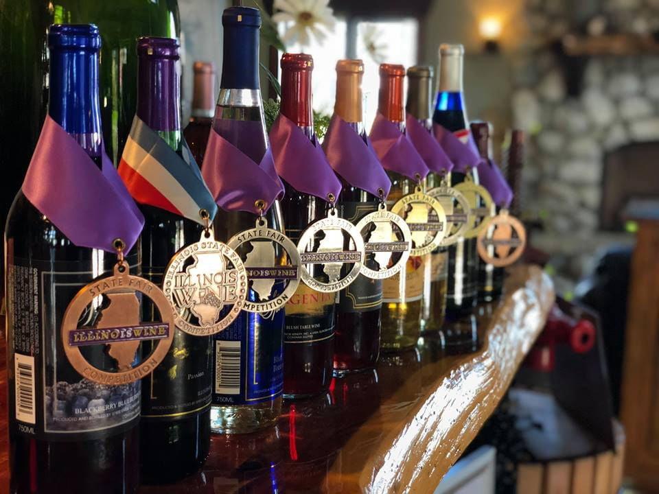 vineyards assortment of award winning wine bottles from the vineyard on a wooden shelf spirit knob winery ursa illinois united states ulocal local products local purchase local produce locavore tourist