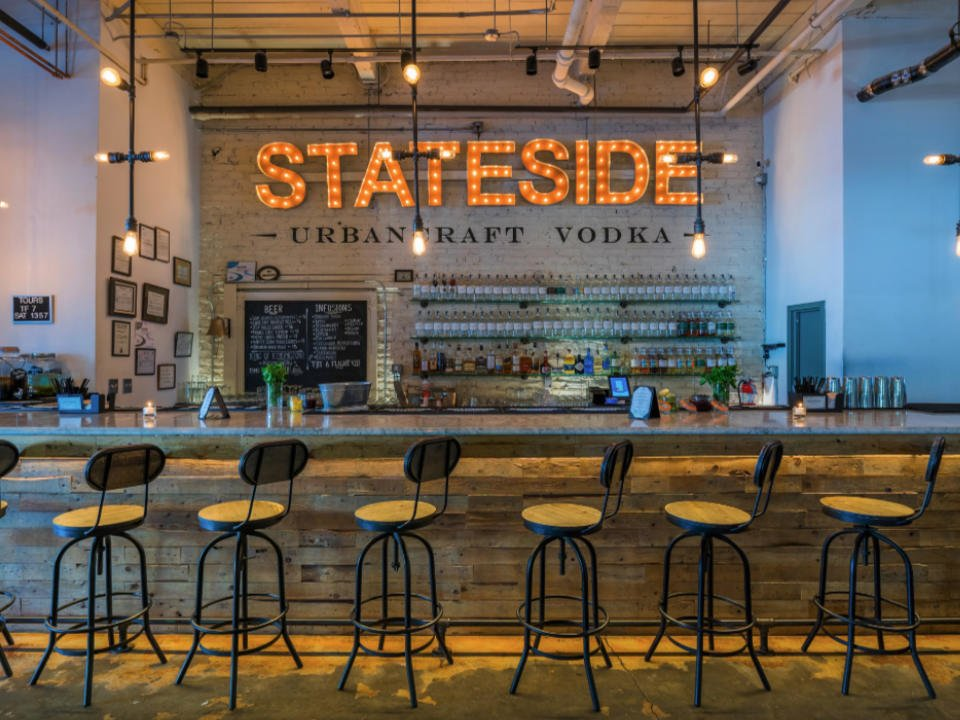 liquor tasting bar with benches and liquor display and illuminated logo on the wall stateside vodka bar philadelphia pennsylvania united states ulocal local products local purchase local produce locavore tourist