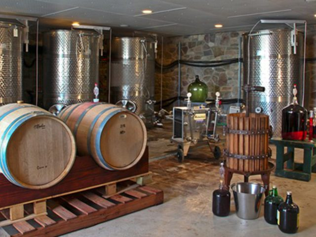vineyards wine cellar with barrels and stainless steel tanks for wine making stonehenge winery and vineyard mt bethel pennsylvania united states ulocal local products local purchase local produce locavore tourist
