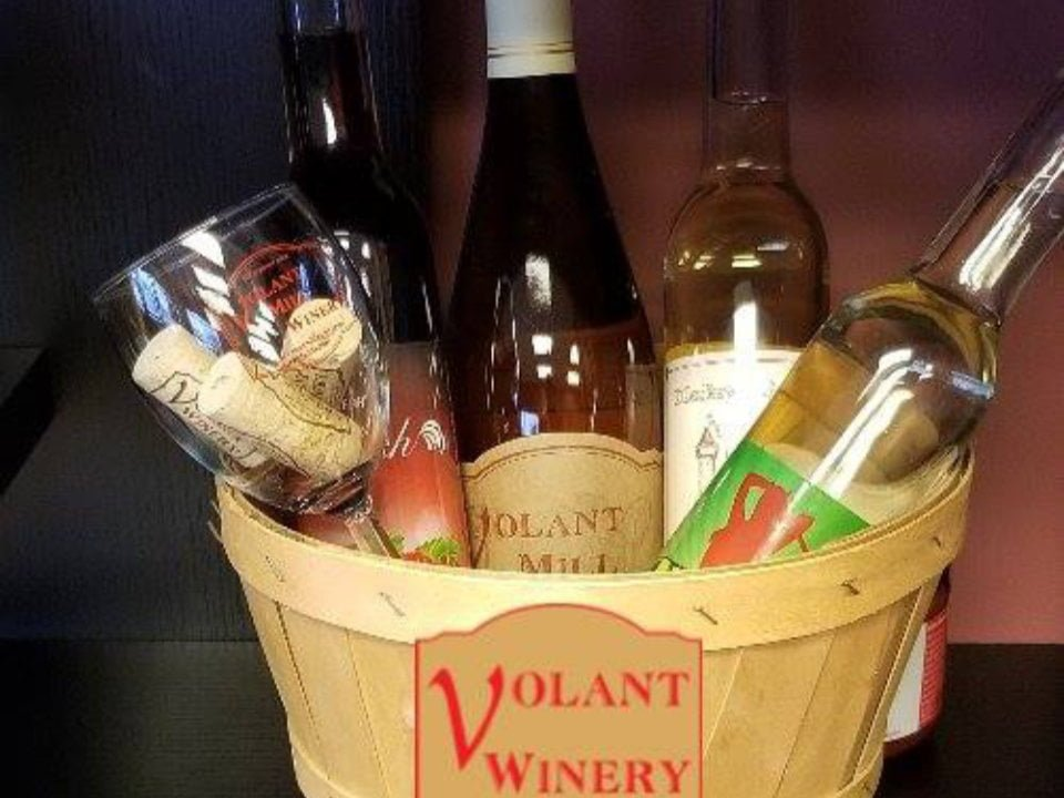 vineyards assortment of wine bottles from the vineyard in a basket volant mill winery volant pennsylvania united states ulocal local products local purchase local produce locavore tourist
