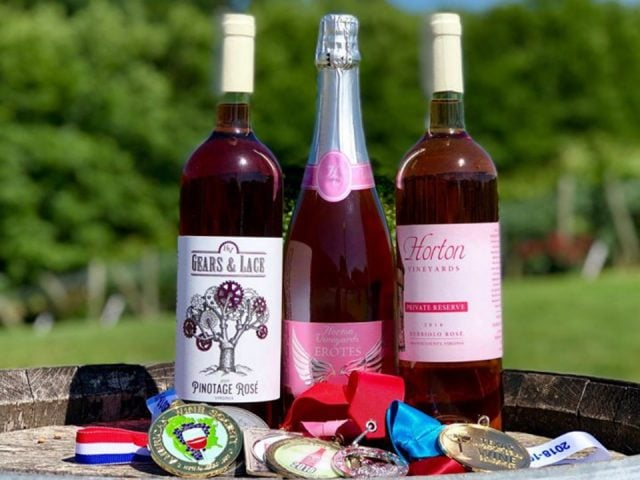 vineyards assortment of 3 award-winning bottles of wine on an outdoor wooden barrel Horton Vineyards Gordonsville virginia united states ulocal local products local purchase local produce locavore tourist