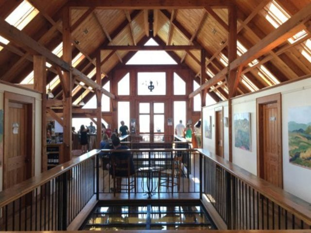 vineyards tasting room with central glazed floor with view of the production room below and cathedral ceiling with wooden beams blenheim vineyards charlottesville virginia united states ulocal local products local purchase local produce locavore tourist