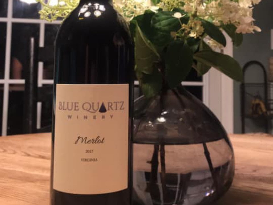 vineyards bottle of red wine next to a pot of white flowers blue quartz winery etlan virginia united states ulocal local products local purchase local produce locavore tourist