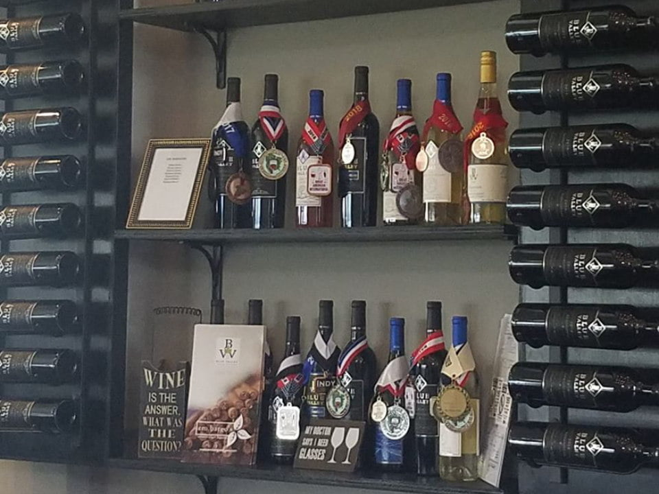vineyards 2 shelves with assorted award-winning wine bottles from the vineyard blue valley vineyard and winery delaplane virginia united states ulocal local products local purchase local produce locavore tourist