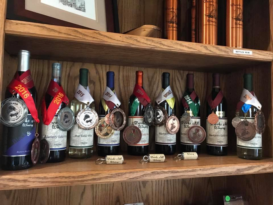 vineyards assortment of award-winning wine bottles on a wooden shelf brooks mill winery wirtz virginia united states ulocal local products local purchase local produce locavore tourist