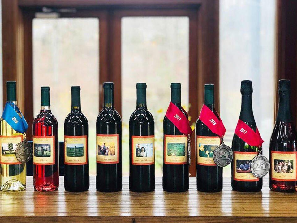 vineyards assortment of award winning wine bottles on a table chisholm vineyards at adventure farm earlysville virginia united states ulocal local products local purchase local produce locavore tourist