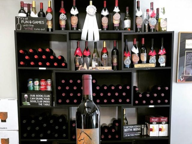 vineyards bottle of wine and shelf with award-winning bottles of wine dry mill vineyards and winery leesburg virginia united states ulocal local products local purchase local produce locavore tourist