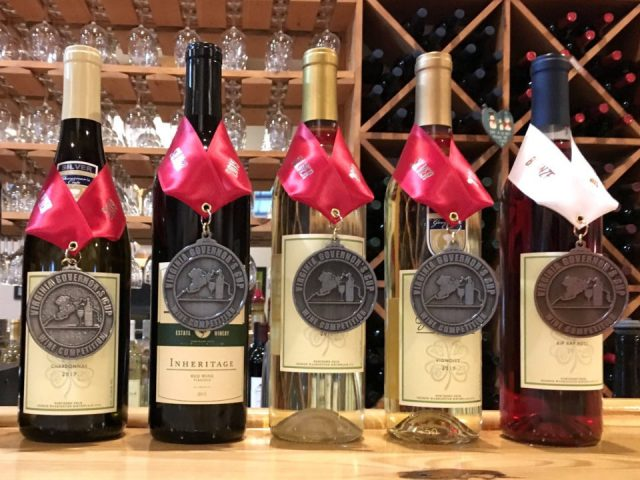 vineyards assortment of award-winning wine bottles on the bar with wooden wine display good luck cellars kilmarnock virginia united states ulocal local products local purchase local produce locavore tourist