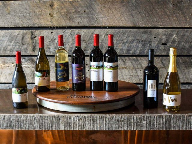 vineyards assortment of wine bottles on the bar with turntable hamlet vineyards bassett virginia united states ulocal local products local purchase local produce locavore tourist
