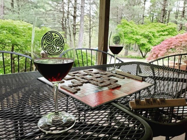 vineyards 2 glasses of wine on a terrace table with a scrabble board hidden brook winery leesburg virginia united states ulocal local products local purchase local produce locavore tourist