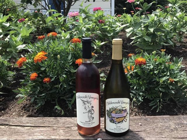 vineyards 2 bottles of wine on the edge of the rock garden hiddencroft vineyards lovettsville virginia united states ulocal local products local purchase local produce locavore tourist