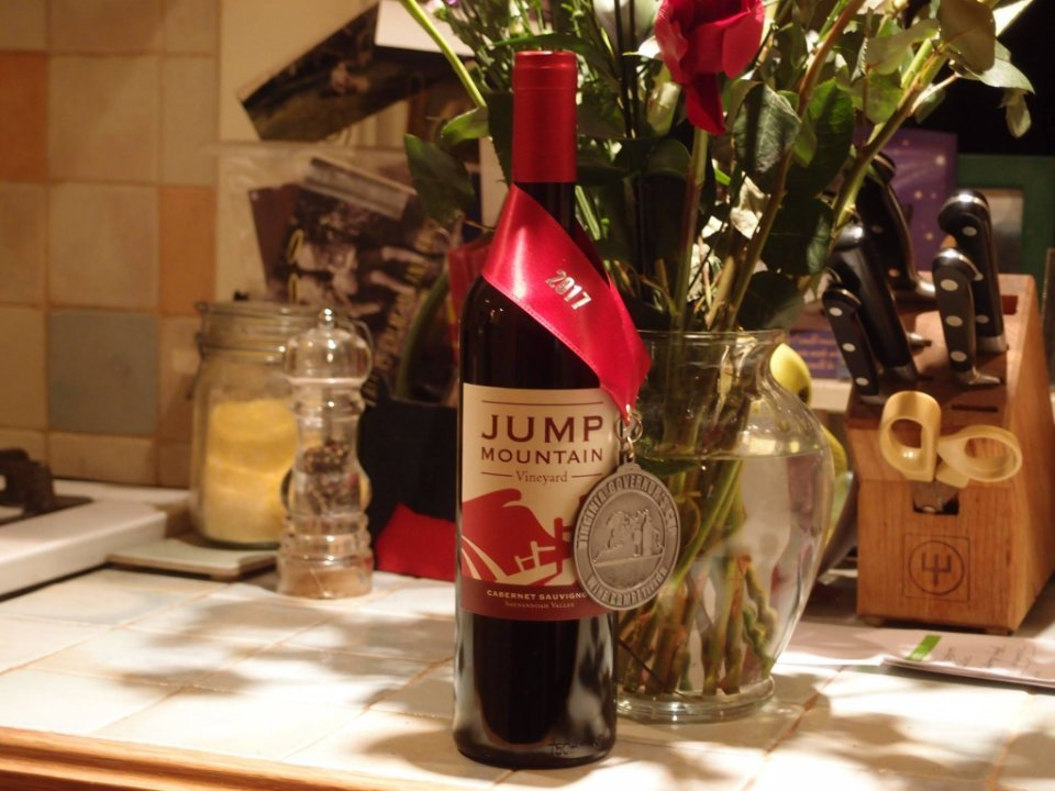 vineyards award winning bottle of wine on the kitchen counter with pot of roses jump mountain vineyard rockbridge baths virginia united states ulocal local products local purchase local produce locavore tourist