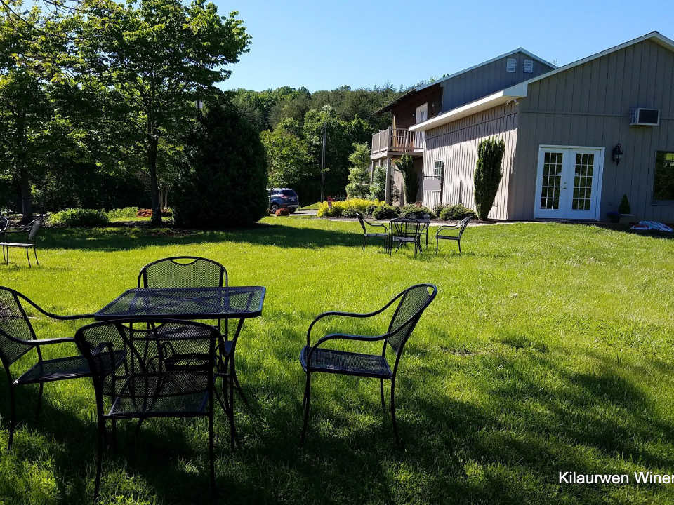 vineyards winery with tables on the ground with trees kilaurwen winery stanardsville virginia united states ulocal local products local purchase local produce locavore tourist