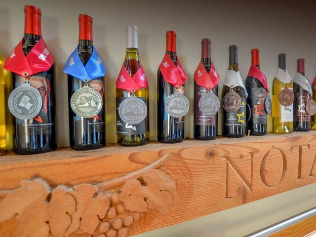 vineyards award-winning wine bottles on a shelf notaviva craft fermentations purcellville virginia united states ulocal local products local purchase local produce locavore tourist