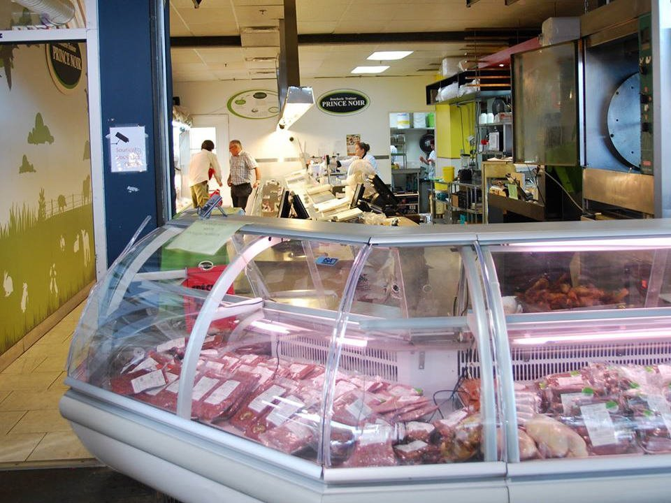 butcher shop interior of butcher's shop with refrigerated counter boucherie prince noir montréal quebec canada ulocal local products local purchase local produce locavore tourist