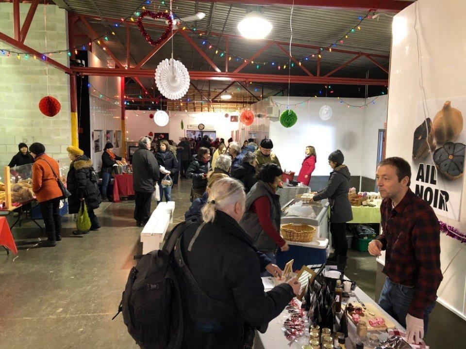 public markets indoor market with visitors marche locavore de racine quebec canada ulocal local products local purchase local produce locavore tourist