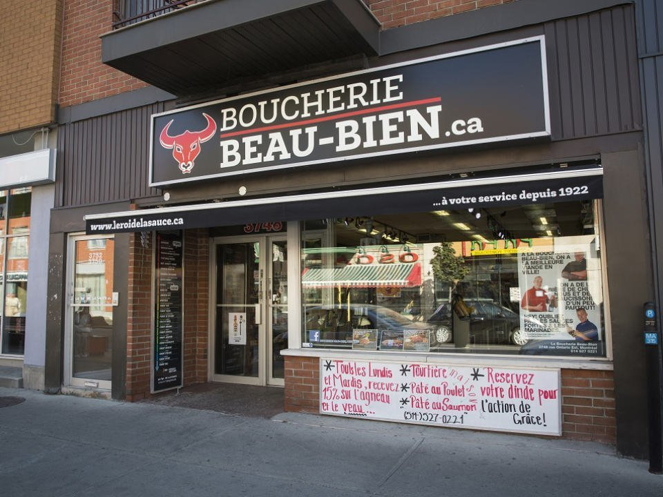 butcher shop facade of the butcher and delicatessen boucherie beau-bien montreal quebec canada ulocal local products local purchase local produce locavore tourist